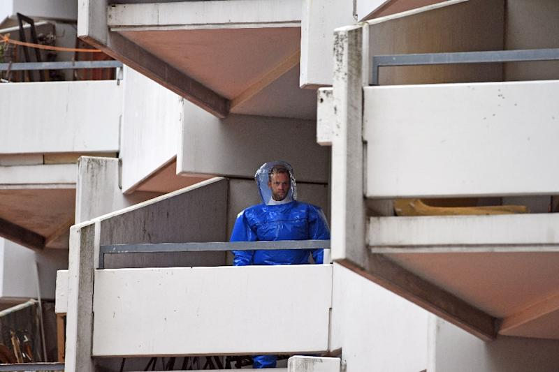 A forensic expert on a balcony at the apartment building in Cologne where a Tunisian-German couple are suspected of producing the deadly poison ricin (AFP Photo/Henning Kaiser)