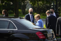 German Chancellor Angela Merkel, center right, leaves after a wreath laying ceremony at the Tomb of Unknown Soldier in Moscow, Russia, Friday, Aug. 20, 2021, prior to talks with Russian President Vladimir Putin. The talks between Merkel and Putin are expected to focus on Afghanistan, the Ukrainian crisis and the situation in Belarus among other issues. (AP Photo/Alexander Zemlianichenko, Pool)