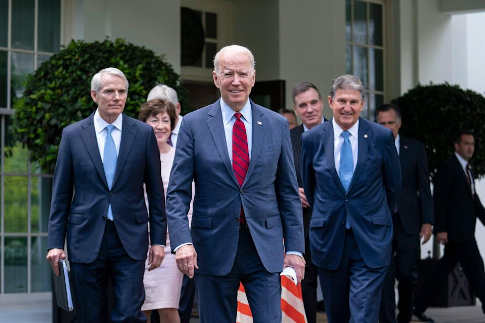 President Joe Biden walks out of the West Wing of the White House following a meeting with a bipartisan group of senators where they reached a deal on an infrastructure plan (EPA)