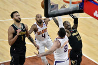 Memphis Grizzlies forward Kyle Anderson (1), Phoenix Suns guard Jevon Carter (4), forward Frank Kaminsky (8), and guard Ja Morant (12) reach for the ball in the second half of an NBA basketball game Monday, Jan. 18, 2021, in Memphis, Tenn. (AP Photo/Brandon Dill)