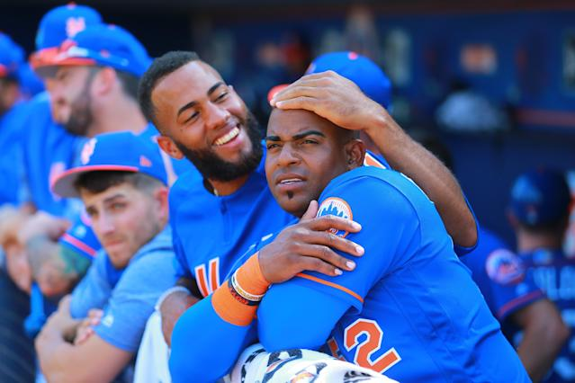 <p>New York Met Amed Rosario checks teammate Yoenis Cespedes's head for home runs in the sixth inning of a baseball game against the Miami Marlins at First Data Field in Port St. Lucie, Fla., March 1, 2018. (Photo: Gordon Donovan/Yahoo News) </p>