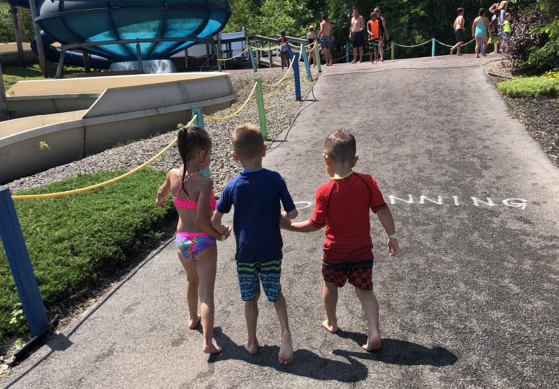 Jeffrey Mackey's two friends Raya and Kane helped him walk throughout the Thunder Island water park in Clay, N.Y. (Credit: Andrea Mackey)