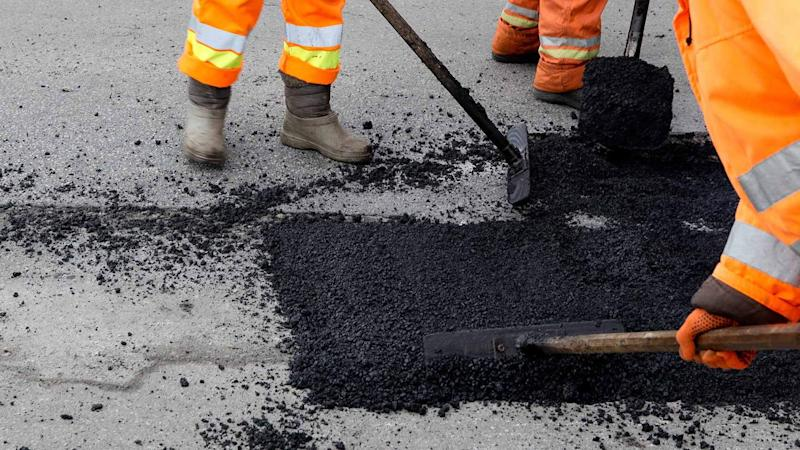 Road workers fixing a pothole
