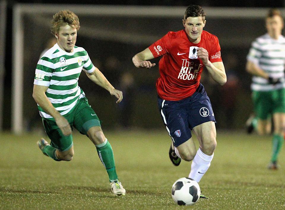HOBART, AUSTRALIA - AUGUST 05:  Andy Brennan (R) of South Hobart controls the ball during the FFA Cup match between South Hobart and Tuggeranong at KGV Park on August 5, 2014 in Hobart, Australia.  (Photo by Robert Prezioso/Getty Images)