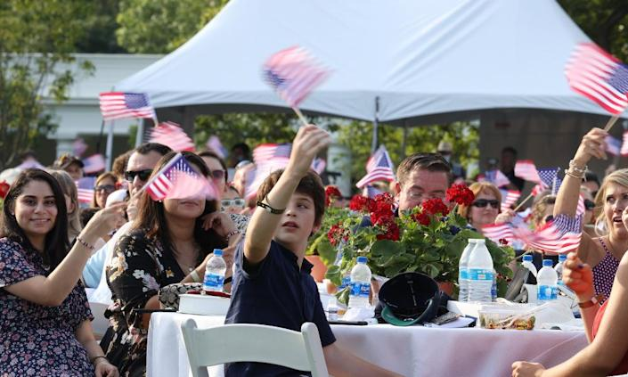 """<span class=""""element-image__caption"""">People attend an event on the South Lawn of the White House on 4 July.</span> <span class=""""element-image__credit"""">Photograph: Tasos Katopodis/Getty Images</span>"""