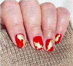 Not into something literal? Swirls of gold leaf and red give nails a super-luxe feel. Don't you think?