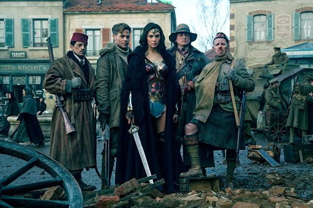 <p>Sameer, Steve, Wonder Woman, Chief, and Charlie strike a post-battle pose. The resulting photo will be unearthed decades later by Lex Luthor (in <em>Batman v Superman</em>) and eventually returned to Diana by Bruce Wayne. (Photo: Warner Bros.)<br> </p>