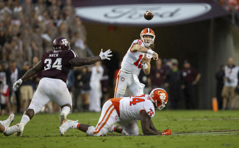 Clemson quarterback Trevor Lawrence (16) throws downfield for a completion against Texas A&M during the first half of an NCAA college football game Saturday, Sept. 8, 2018, in College Station, Texas. (AP Photo/Sam Craft)