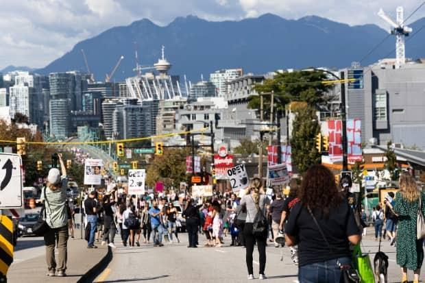 Thousands of people protest against vaccination passports near Vancouver City Hall on Sept. 1. (Gian Paolo Mendoza/CBC - image credit)