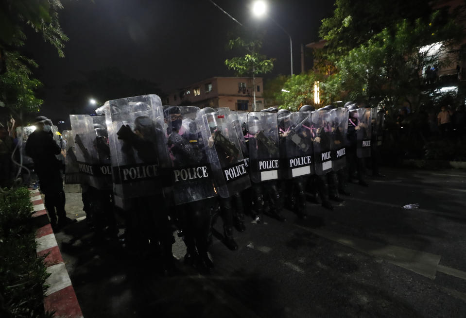 Police hold shields in tight formation as pro-democracy protesters demanding the release of pro-democracy activists march in Bangkok, Thailand, Wednesday, Feb. 10, 2021. Protesters demanded the government to step down, the constitution to be amended to make it more democratic and the monarchy be more accountable. (AP Photo/Sakchai Lalit)