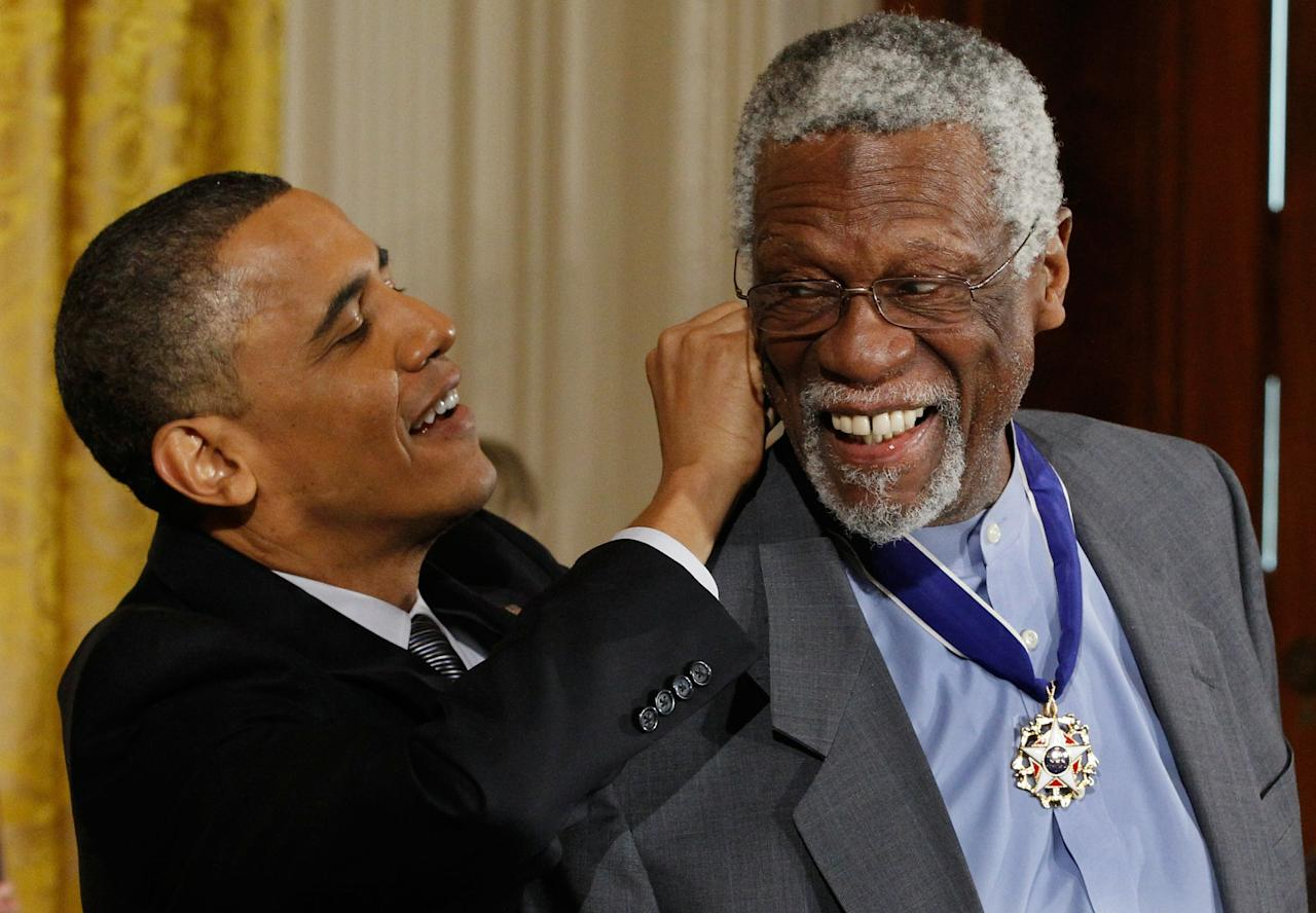 WASHINGTON, DC - FEBRUARY 15:  U.S. President Barack Obama (L) presents Basetball Hall of Fame member and human rights advocate Bill Russell the 2010 Medal of Freedom in the East Room of the White House February 15, 2011 in Washington, DC. Obama presented the medal to twelve pioneers in sports, labor, politics and arts.  (Photo by Chip Somodevilla/Getty Images)