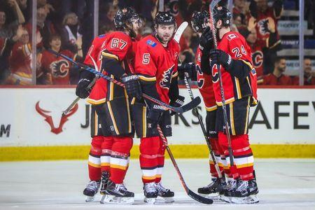 Jan 11, 2019; Calgary, Alberta, CAN; Calgary Flames defenseman Mark Giordano (5) celebrates his goal with teammates against the Florida Panthers during the second period at Scotiabank Saddledome. Mandatory Credit: Sergei Belski-USA TODAY Sports