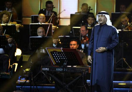 FILE PHOTO: Saudi Arabian singer Mohammed Abdu peforms during a concert in Riyadh, Saudi Arabia, March 9, 2017. Picture taken March 9, 2017. REUTERS/Faisal Al Nasser/File Photo
