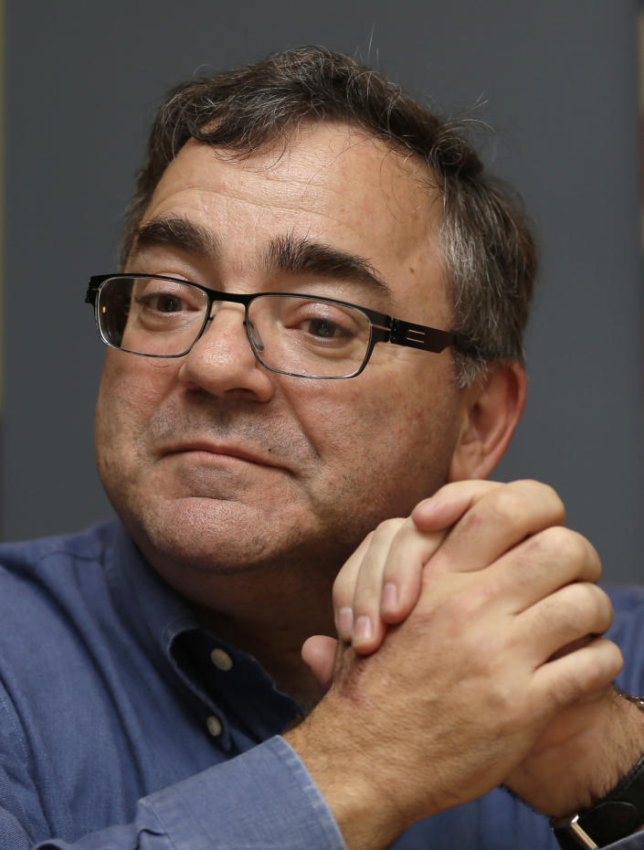 In this photo taken Thursday, Jan. 9, 2014, Spirit Airlines CEO Ben Baldanza pauses as he talks to a reporter at his home, in Fort Lauderdale, Fla. (AP Photo/Alan Diaz)
