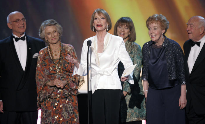 """FILE - In this Jan. 2007 file photo, the cast of """"The Mary Tyler Moore Show,"""" from left, Gavin MacLeod, Cloris Leachman, Mary Tyler Moore, Valerie Harper, Georgia Engel and Ed Asner, present the award for outstanding performance by an ensemble in a comedy series at the 13th Annual Screen Actors Guild Awards, in Los Angeles. Gavin MacLeod has died. His nephew told the trade paper Variety that MacLeod died early Saturday, May 29, 2021. (AP Photo/Mark J. Terrill, File)"""