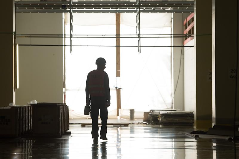 07 October 2019, Saxony, Dresden: A construction worker walks through a future production hall on the construction site of Bosch's new semiconductor factory and sees a silhouette. The semiconductor plant, which Bosch is currently building in the state capital for around one billion euros, is to become a showcase project in terms of digitization and automated production. Photo: Sebastian Kahnert/dpa-Zentralbild/dpa (Photo by Sebastian Kahnert/picture alliance via Getty Images)