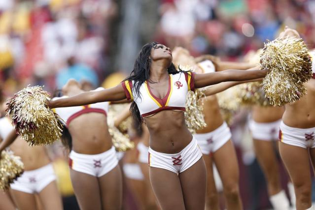 LANDOVER, MD - AUGUST 25: Washington Redskins cheerleaders entertain on the field during a preseason NFL game against the Indianapolis Colts at FedEx Field on August 25, 2012 in Landover, Maryland. The Redskins beat the Colts 30-17. (Photo by Joe Robbins/Getty Images)