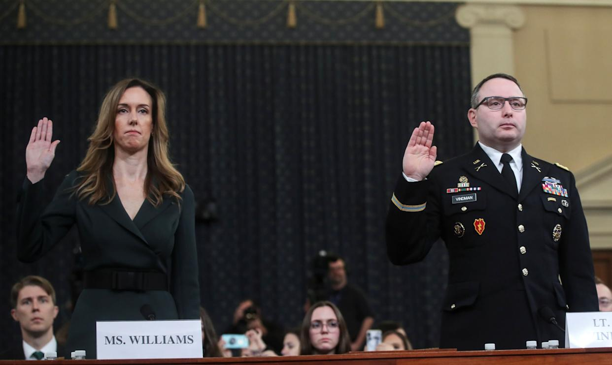 Jennifer Williams, a special adviser to Vice President Mike Pence for European and Russian affairs; and Alexander Vindman, director for European Affairs at the National Security Council, are sworn in to testify before a House Intelligence Committee hearing as part of the impeachment inquiry into U.S. President Donald Trump, Nov. 19, 2019. (Photo: Jonathan Ernst / Reuters)