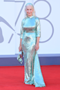 <p>Helen Mirren knocks it out of the park in this sequin mint-hued Dolce & Gabbana dress, complete with a matching headband and clutch bag, for the Madres Paralela showing.</p>