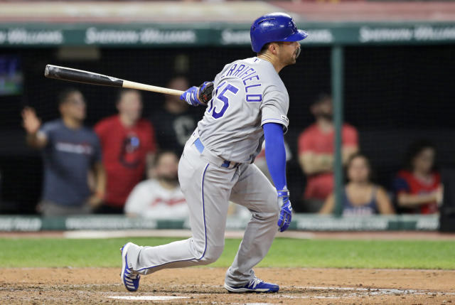Kansas City Royals' Whit Merrifield watches his ball after hitting a single in the eighth inning of a baseball game against the Cleveland Indians, Saturday, July 20, 2019, in Cleveland. (AP Photo/Tony Dejak)