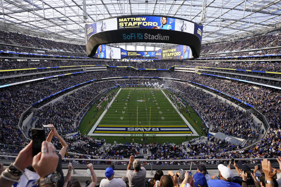 Fans react in SoFi stadium before an NFL football game between the Los Angeles Rams and the Chicago Bears, Sunday, Sept. 12, 2021, in Inglewood, Calif. (AP Photo/Jae C. Hong)