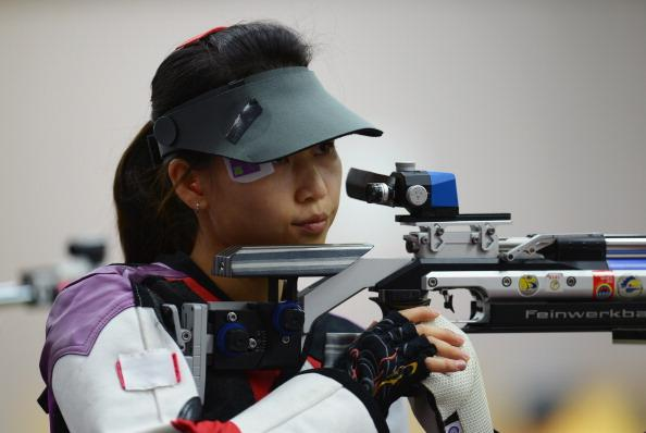 LONDON, ENGLAND - JULY 28:  Siling Yi of China competes in the Women's 10m Air Rifle Shooting qualification on Day 1 of the London 2012 Olympic Games at The Royal Artillery Barracks on July 28, 2012 in London, England.  (Photo by Lars Baron/Getty Images)