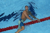 Caeleb Dressel, of the United States, after swimming to victory in a men's 100m butterfly semifinal at the 2020 Summer Olympics, Friday, July 30, 2021, in Tokyo, Japan. (AP Photo/Jeff Roberson)