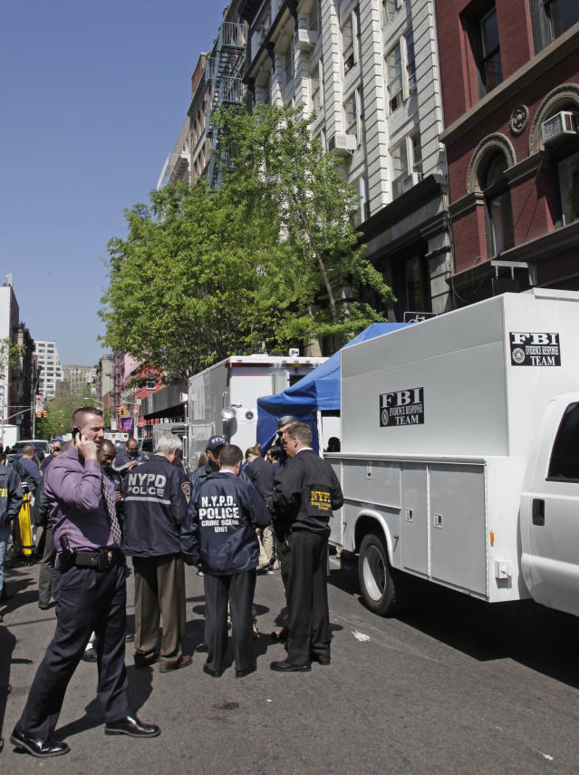 FBI and NYPD law enforcement officials search a SoHo basement at the corner of Wooster and Prince streets for the possible remains of missing child Etan Patz on Thursday, April 19, 2012 in New York. Patz vanished in 1979 after leaving his family's SoHo home for a short walk to his school bus stop. NYPD spokesman Paul Browne says the building being searched is about a block from where the family lived. (AP Photo/Bebeto Matthews)