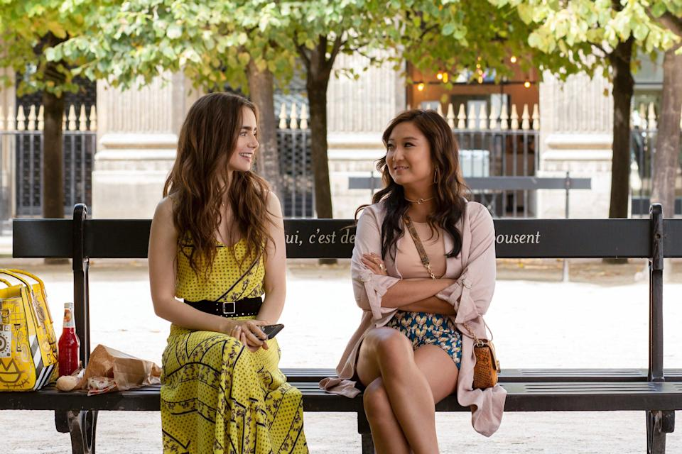"While Mindy tells Emily that she ""look[s] American"" in this yellow look, the tank-skirt set is actually the product of popular Danish fashion export Ganni. The matching bag is designed by Field, while the sold-out belt is from Rag & Bone."