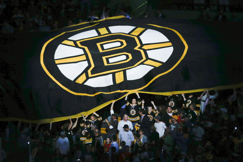 Fans pass a Boston Bruins banner through the stands before Game 4 of the NHL hockey Stanley Cup Finals between the Bruins and the Chicago Blackhawks, Wednesday, June 19, 2013, in Boston. (AP Photo/Charles Krupa)