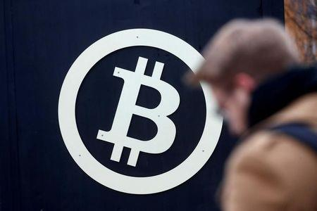 FILE PHOTO: A bitcoin sign is seen during Riga Comm 2017, a business technology and innovation fair in Riga, Latvia November 9, 2017.  REUTERS/Ints Kalnins/File Photo