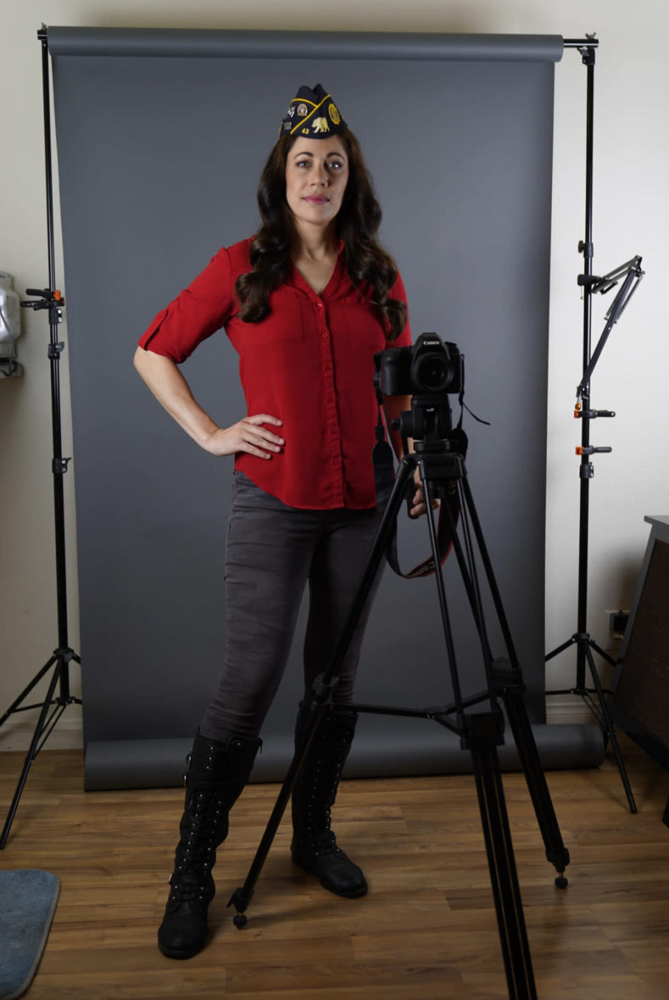 """In this June 30, 2021, photo, Los Angeles-based producer, actress and Marine Corps veteran Jennifer Brofer poses at her apartment in Los Angeles. Brofer will never forget the loud, popping noise. It was on a hot July afternoon in 2010 when her convoy rolled over an IED on a road in Helmand Province four months into her deployment to Afghanistan. Her heart froze as she and her fellow Marines stopped and realized what had occurred. But what followed were only the sounds of daily life. Brofer, 38, who now works in the film industry in Hollywood, said she feels proud to have served """"shoulder-to-shoulder with my male marine counterparts"""" in a time of war. (AP Photo/Damian Dovarganes)"""