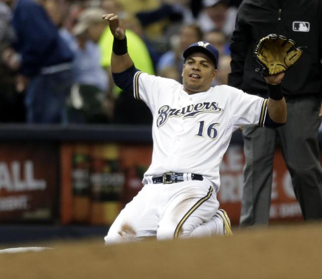 Milwaukee Brewers' Aramis Ramirez reacts after throwing out Atlanta Braves' Andrelton Simmons in the seventh inning of an opening day baseball game Monday, March 31, 2014, in Milwaukee. (AP Photo/Jeffrey Phelps)