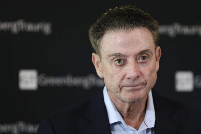 FILE - In this Feb. 21, 2018, file photo, former Louisville basketball coach Rick Pitino talks to reporters during a news conference in New York. The University of Louisville Athletic Association and Rick Pitino have agreed to settle a federal lawsuit, with the former Cardinals men's basketball coach's changing his termination to a resignation. The settlement unanimously approved Wednesday, Sept. 18, 2019, by the ULAA states that Pitino has received compensation and the school agrees not to pursue further legal action. (AP Photo/Seth Wenig, File)
