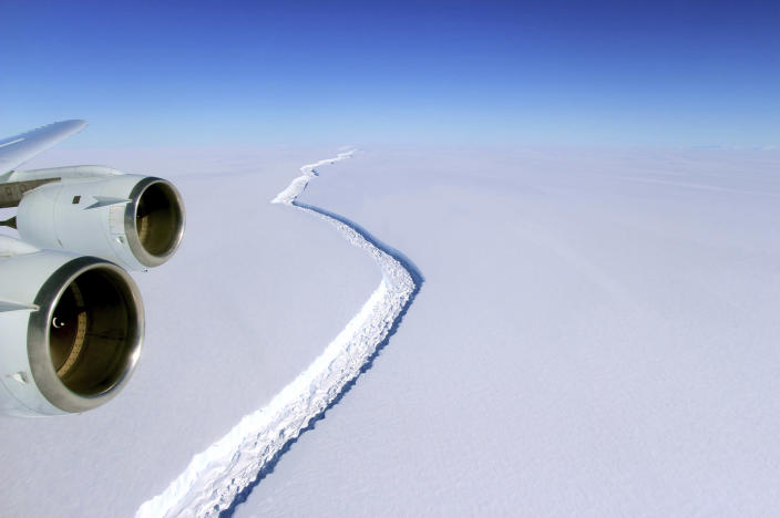 <p>Aerial photo showing a rift in the Antarctic Peninsula's Larsen C ice shelf, Nov. 10, 2016. According to NASA, IceBridge scientists measured the Larsen C fracture to be about 70 miles long, more than 300 feet wide and about a third of a mile deep. (John Sonntag/NASA via AP) </p>