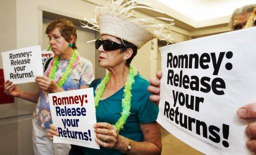 "<p>Members of MoveOn.org protest on July 13, at Mitt Romney's campaign office in Arlington, Virginia. Romney angrily blunted ""false"" attacks about his time at Bain Capital but did not cede to demands to release more tax returns that have dogged his White House bid</p>"