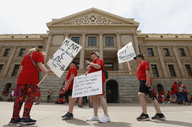 <p>Thousands march on the Arizona Capitol for higher teacher pay and school funding on the first day of a state-wide teachers strike Thursday, April 26, 2018, in Phoenix. (Photo: Ross D. Franklin/AP) </p>