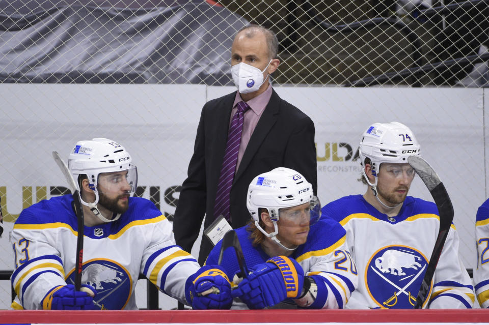 FILE - Buffalo Sabres interim head coach Don Granato watches from the bench during an NHL hockey game against the Philadelphia Flyers in Philadelphia, in this Sunday, April 11, 2021, file photo. Tony Granato can now laugh in recalling how angry he was at his brother Don for giving up goaltending at 15 and switching to forward. That might have been the last time Tony questioned his brother's life decisions. (AP Photo/Derik Hamilton, File)