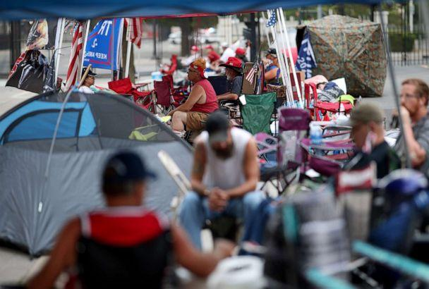 PHOTO: Supporters of President Donald Trump line up to attend the Trump's campaign rally near the BOK Center, site of tomorrow's rally, June 19, 2020 in Tulsa, Okla. (Win Mcnamee/Getty Images)
