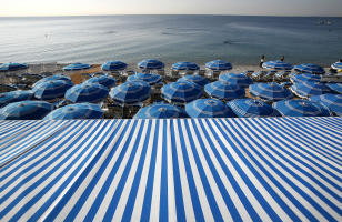 Blue and white beach umbrellas