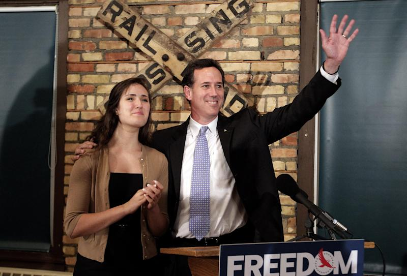 Republican presidential candidate, former Pennsylvania Sen. Rick Santorum, right, is joined by his daughter Sarah Maria during a news conference in Green Bay, Wis., Saturday, March 24, 2012. Santorum won the Louisiana Republican presidential primary Saturday, beating front-runner Mitt Romney in the race to challenge President Barack Obama. (AP Photo/Jae C. Hong)