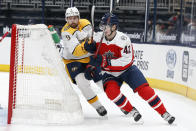 Nashville Predators Filip Forsberg, left, and Columbus Blue Jackets' Alexandre Texier chase a loose puck behind the net during the first period of an NHL hockey game Saturday, Feb. 20, 2021, in Columbus, Ohio. (AP Photo/Jay LaPrete)