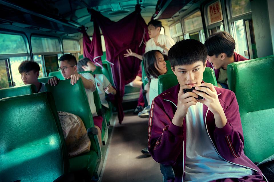 "Liu Tzu-chuan as Chang Cheng, oblivious to the ""game"" taking place at the back of the bus in The Silent Forest. (Photo: mm2 Entertainment)"