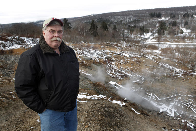 <p> FILE -- This Jan. 13, 2010 file photo shows steam rising from the ground around retired Centralia Postmaster Tom Dempsey as he stands in an area that was in Centralia, Pa. The steam is caused by a fire that was still burning underground after it started in 1962 at the town dump and ignited an exposed coal vein. The underground fire eventually forced an exodus of more than 1,000 people, nearly the entire population. The attorney for the few remaining residents of the central Pennsylvania coal town that was decimated by a 50-year-old mine fire said on Thursday, Oct. 31, 2013, that they have settled their lawsuit against state officials who have been trying for years to evict them. The settlement allows eight Centralia residents to stay in their homes for as long as they live and it also includes a cash payout. (AP Photo/Carolyn Kaster, FILE)