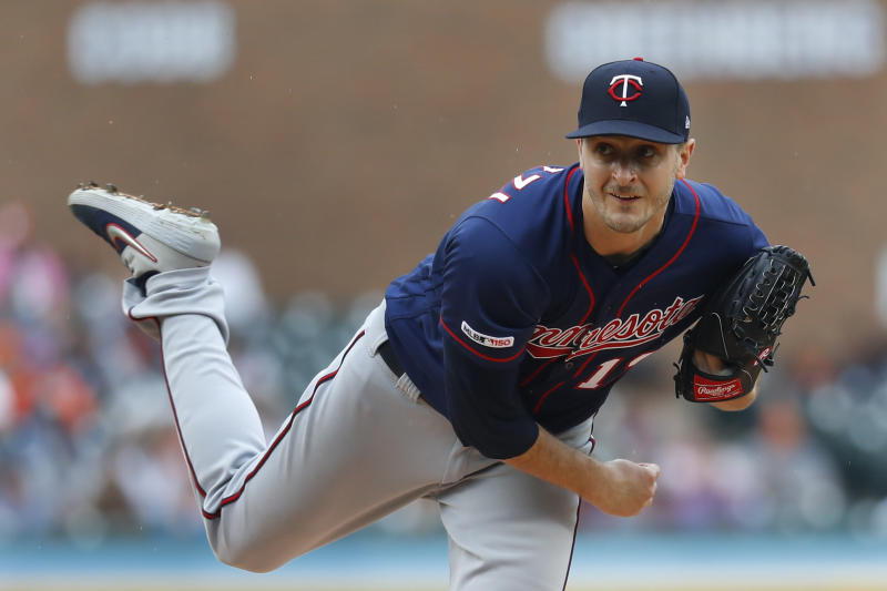 Minnesota Twins pitcher Jake Odorizzi throws against the Detroit Tigers in the first inning of a baseball game in Detroit, Sunday, June 9, 2019. (AP Photo/Paul Sancya)
