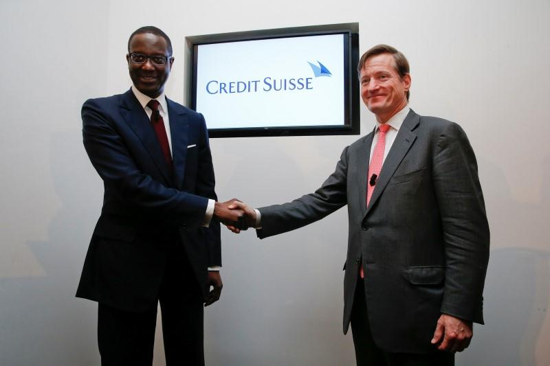 Credit Suisse outgoing Chief Executive Dougan and Thiam shake hands after a Credit Suisse news conference in Zurich