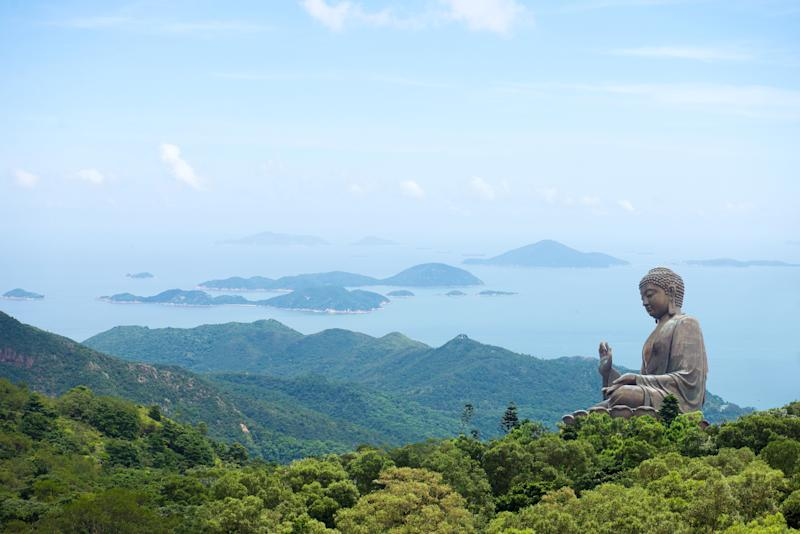 "While sailing in Hong Kong, Charlie and Astrid pass Lantau Island, and Charlie bows at the bronze ""Big Buddha"" statue."