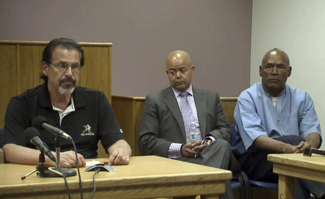 <p>Bruce Fromong testifies for former NFL football star O.J. Simpson, far right, as attorney, Malcolm LaVergne, center, listens during Simpson's hearing at the Lovelock Correctional Center in Lovelock, Nev., on Thursday, July 20, 2017. Fromong, one of the sports memorabilia dealers in the robbery that put Simpson in prison, told the Nevada parole board that the former sports star apologized to him and he accepted it. (KOLO-TV via AP, POOL) </p>