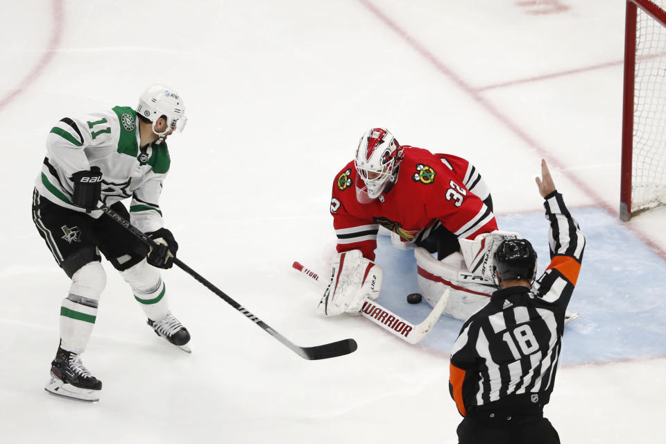 Dallas Stars center Andrew Cogliano (11) scores a short handed goal past Chicago Blackhawks goaltender Kevin Lankinen (32) during the third period of an NHL hockey game Tuesday, April 6, 2021, in Chicago. (AP Photo/Jeff Haynes)