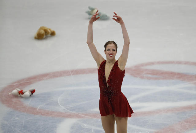 Italy's Carolina Kostner acknowledges the applause at the end of her performance during women's short program at the Figure Skating World Championships in Assago, near Milan, Wednesday, March 21, 2018. (AP Photo/Antonio Calanni)